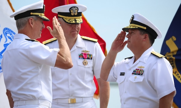 DAHLGREN, Va. (Aug. 25, 2016) - Rear Adm. Tom Druggan, right, commander, Naval Surface Warfare Center, salutes Vice Adm. Thomas Moore, commander, Naval Sea Systems Command, during a change of command ceremony. Druggan relieved Rear Adm. Lorin Selby, center, as NSWC commander at the first change of command ceremony held on the NSWC Dahlgren Division Potomac River Test Range gunline.