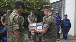 U.S. Marines from Provost Marshal's Office K-9 unit trained with Hiroshima Prefectural Police Headquarters officers and the Japan Maritime Self-Defense Force Kure Repair and Supply Facility Petroleum Terminal unit military working dog handlers at Marine Corps Air Station Iwakuni, Japan, Aug. 24, 2016. Handlers and their military working dogs train regularly in a variety of areas such as locating explosives and narcotics, conducting patrols and human tracking in order to become a more effective team.