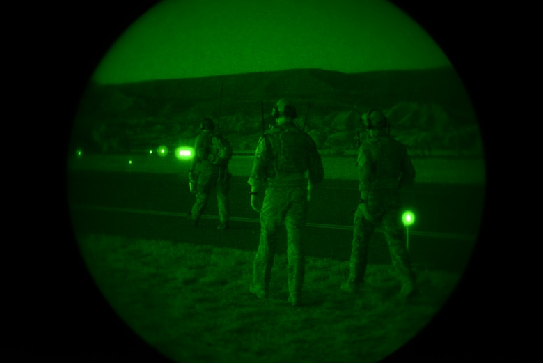 Special Tactics Airmen from the 24th Special Operations Wing coordinate a Forward Area Refueling Point during a night-time training scenario in Montrose, Colo., July 26, 2016. A FARP provides a tactical refueling capability to aircraft and units operating in remote locations. The full mission profile provided these Airmen an opportunity to practice their core competencies and hone their skills in unfamiliar terrain similar to what they might encounter downrange. (U.S. Air Force photo/Staff Sgt. Eboni Reams)
