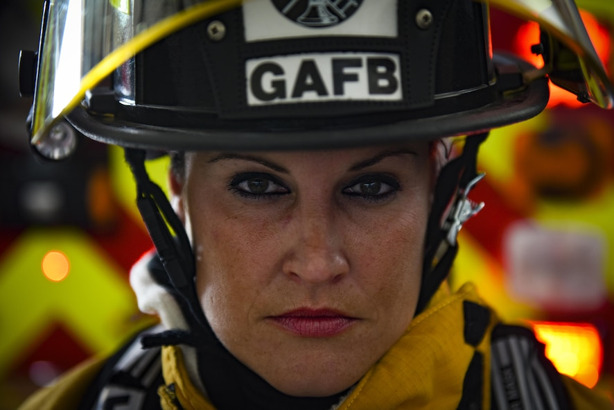 Krystell Clemons, 17th Civil Engineer Squadron firefighter, dons her bunker gear at the 17th CES Fire Emergency Services fire department on Goodfellow Air Force Base, Texas, Aug. 24, 2016. Krystell represents the women throughout history who've broken the mold and historical standards for the observation of Women's Equality Day Aug. 26. (U.S. Air Force photo by Airman 1st Class Caelynn Ferguson/Released)