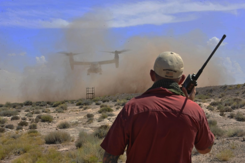 A combat controller directs a CV-22 for landing during a training exercise in Green River, Utah, July 26, 2016. The full mission profile provided these Airmen an opportunity to practice their core competencies and hone their skills in unfamiliar terrain similar to what they might encounter overseas. (U.S. Air Force photo/Staff Sgt. Eboni Reams)