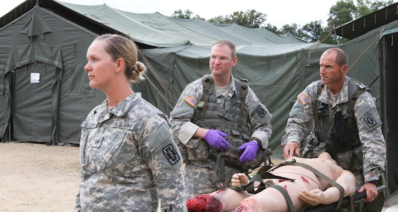 FORT MCCOY, Wis -- Army Reserve Soldiers from the 75th Combat Support Hospital out of San Antonio, Texas, lift a mannequin with grevious leg injuries and prepare for medical evacuation during the Global Medic Exercise at Fort McCoy, Wis. on Aug. 20, 2016. Global Medic is an inter-service training event that develops and evaluates the collective skills of Army Reserve Soldiers and other service members in a collaborative environment. (U.S. Army Reserve photo by Spc. Christopher A. Hernandez, 345th Public Affairs Detachment)