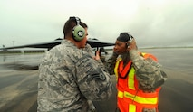 U.S. Air Force Chief Master Sgt. Melvina Smith, the 509th Bomb Wing command chief, (right) is instructed by Staff Sgt. Joshua Layton, a dedicated crew chief assigned to the 509th Aircraft Maintenance Squadron, on marshaling procedures at Andersen Air Force Base, Guam, Aug. 23, 2016. While visiting deployed Airmen from Whiteman Air Force Base, Mo., Smith experienced first-hand the routines crew chiefs perform while on the flightline. (U.S. Air Force photo by Senior Airman Jovan Banks)