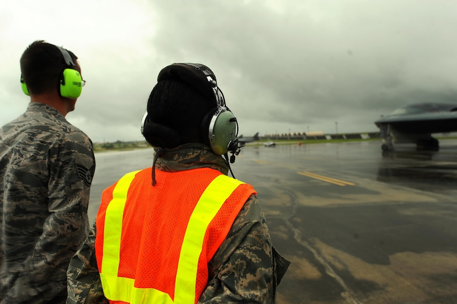 U.S. Air Force Chief Master Sgt. Melvina Smith, the 509th Bomb Wing command chief, (right) and Staff Sgt. Matthew Helms, a dedicated crew chief assigned to the 509th Aircraft Maintenance Squadron prepare to marshal a B-2 Spirit at Andersen Air Force Base, Guam, Aug. 23, 2016. While visiting deployed Airmen from Whiteman Air Force Base, Mo., Smith experienced first-hand the routines crew chiefs perform while on the flightline. (U.S. Air Force photo by Senior Airman Jovan Banks)