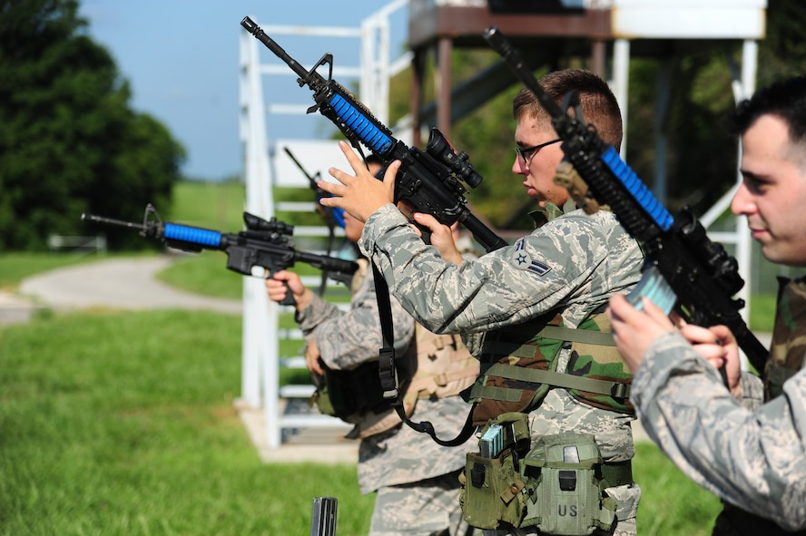 Airmen from the 509th Munitions Squadron practice rapid reloading before participating in shoot, move and communicate training at Whiteman Air Force Base, Mo., Aug. 18, 2016. The training consisted of basic shooting stances, reaction to fire, providing cover, and advancing positions all while engaging a simulated target. (U.S. Air Force photo by Senior Airman Joel Pfiester)