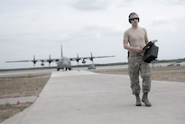 Air Force Senior Airman Zachary Allen, a flight equipment technician assigned to the 120th Airlift Wing, Montana Air National Guard, returns from post-flight-checking aircrew equipment aboard a C-130 Hercules cargo aircraft during Northern Strike Exercise 2016 in Alpena, Mich., Aug. 11, 2016. Air National Guard photo by Master Sgt. Leisa Grant
