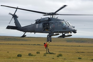 Technical Sgt. Cody Inman, a pararescueman with the 212th Rescue Squadron, Joint Base Elmendorf-Richardson, Alaska, is hoisted into a HH-60 Pavehawk helicopter during Exercise Arctic Chinook Aug. 24, 2016.  Exercise Arctic Chinook is a joint U.S. Coast Guard and U.S. Northern Command-sponsored exercise on the U.S. State Department approved list of Arctic Council Chairmanship events. The Arctic mass rescue operation exercise scenario consisted of an adventure-class cruise ship with approximately 200 passengers and crew that experience a catastrophic event with the need to abandon ship. Arctic Chinook exercised elements of the Arctic Search and Rescue Agreement to include interoperability, cooperation, information sharing, SAR services, and joint exercise review.