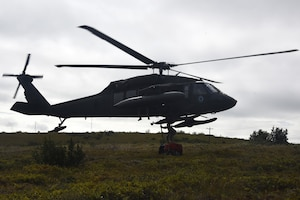 An Alaska Guard UH-60 Blackhawk helicopter picks up medical gear during Exercise Arctic Chinook Aug. 24, 2016.  Exercise Arctic Chinook is a joint U.S. Coast Guard and U.S. Northern Command-sponsored exercise on the U.S. State Department approved list of Arctic Council Chairmanship events. The Arctic mass rescue operation exercise scenario consisted of an adventure-class cruise ship with approximately 200 passengers and crew that experience a catastrophic event with the need to abandon ship. Arctic Chinook exercised elements of the Arctic Search and Rescue Agreement to include interoperability, cooperation, information sharing, SAR services, and joint exercise review.