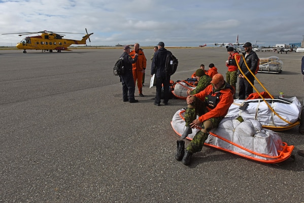 Royal Canadian Airmen prepare to disembark during Exercise Arctic Chinook Aug. 24, 2016.  Exercise Arctic Chinook is a joint U.S. Coast Guard and U.S. Northern Command-sponsored exercise on the U.S. State Department approved list of Arctic Council Chairmanship events. The Arctic mass rescue operation exercise scenario consisted of an adventure-class cruise ship with approximately 200 passengers and crew that experience a catastrophic event with the need to abandon ship. Arctic Chinook exercised elements of the Arctic Search and Rescue Agreement to include interoperability, cooperation, information sharing, SAR services, and joint exercise review.