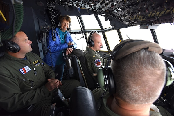 U.S. Senator Lisa Murkowski speaks with U.S. Coast Guard Cmdr. Nahashon Almondmoss (right) and Lt. Cmdr Mike Angeli (middle-right) in route to Kotzebue, Alaska aboard a USCG C-130 Aug. 24, 2016. More than 60 distinguished visitors flew to Kotzebue to observe Exercise Arctic Chinook, which is a joint USCG and U.S. Northern Command-sponsored exercise on the U.S. State Department approved list of Arctic Council Chairmanship events. The Arctic mass rescue operation exercise scenario consisted of an adventure-class cruise ship with approximately 200 passengers and crew that experience a catastrophic event with the need to abandon ship. Arctic Chinook exercised elements of the Arctic Search and Rescue Agreement to include interoperability, cooperation, information sharing, SAR services, and joint exercise review.