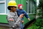 Army Spc. Raven Henderson, assigned to the 375th Engineer Company, 467th Engineer Battalion, 926th Engineer Brigade, 412th Theater Engineer Command, holds a child from Kudikiu Namai during a Humanitarian Civil Assistance project in Sauliai, Lithuania, Aug. 18, 2016. Photo by Pfc. Emily Houdershieldt
