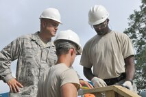 Senior Master Sgt. Brian Phillips, Civil Engineer heavy repair superintendent, talks with Tech. Sgt. David Morrison (right) and Staff Sgt. Dominick Tami (center), both Civil Engineer structural engineers, during a project to put the finishing touches on a new staircase leading from the Veteran's Park to the riverside here, Aug. 25, 2016. Phillips, Morrison and Tami are members of a small team from the 910th Civil Engineer Squadron, based at nearby Youngstown Air Reserve Station (YARS), Ohio, who teamed up with the City of Newton Falls to undertake a three-week project to demolish the existing staircase and design and build the new stairs under Department of Defense's Realistic Military Training program and the Air Force Community Partnership Program. The program is designed to identify and develop mutually beneficial partnerships between Air Force installations and surrounding communities. (U.S. Air Force photo/Master Sgt. Bob Barko Jr.)