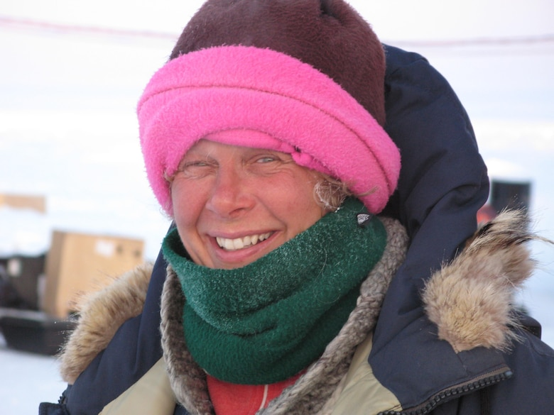 Dr. Jackie Richter-Menge in the field wearing her signature pink hat, a distinguishing feature when she is in the field.
