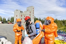 U.S. Army Staff Sgt. Andrew Markham, an Alaska Army National Guard Chemical, Biological, Radiological and Nuclear noncommissioned officer assigned to the 103rd Weapons of Mass Destruction-Civil Support Team out of Kulis Air National Guard Base, Alaska, goes through a chemical decontamination point during an exercise Aug. 23, 2016, at the Fairbanks Regional Fire Training Center in Fairbanks, Alaska. During  the exercise, participants had to be decontaminated before leaving a contaminated area, known as the hot zone. (U.S. Air Force photo by Airman Isaac Johnson)