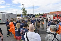 U.S. military and civilian participants of a Chemical, Biological, Radiological, Nuclear and Environmental exercise receive a briefing on a scenario they will participate in Aug. 23, 2016, at the Fairbanks Regional Fire Training Center in Fairbanks, Alaska. Members of the 354th Civil Engineer Squadron, 103rd Weapons of Mass Destruction-Civil Support Team, Fairbanks Fire Department, and the FBI participated in the exercise. (U.S. Air Force photo by Airman Isaac Johnson)