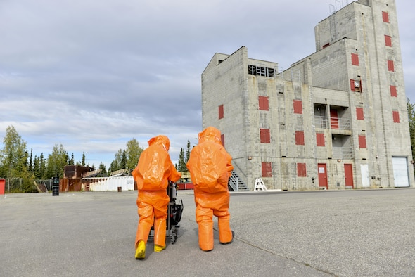 U.S. Air Force Senior Airman Eric McComb and U.S. Army Staff Sgt. Andrew Markham, both Chemical, Biological, Radiological and Nuclear (CBRN) technicians with the 103rd Weapons of Mass Destruction-Civil Support Team (WMD-CST), out of Kulis Air National Guard Base, Alaska, walk toward a building with potential CBRN threats Aug. 23, 2016, at the Fairbanks Regional Fire Training Center in Fairbanks, Alaska. The 103rd WMD-CST is a joint unit thats includes both Alaska Air National Guard and Alaska Army National Guard. (U.S. Air Force photo by Airman Isaac Johnson)