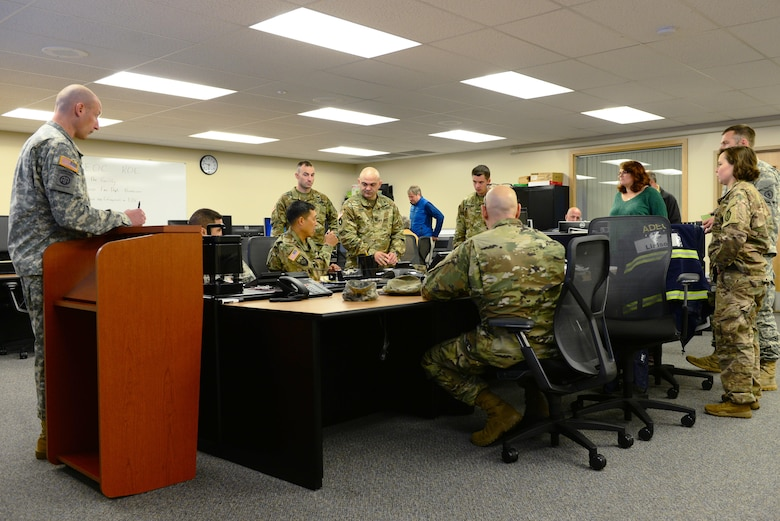 Multiple agencies from Fairbanks, Eielson Air Force Base, Fort Wainwright and the Alaska Army National Guard's 103rd Weapons of Mass Destruction-Civil Support Team (WMD-CST) gather together in the Emergency Operations Center for a Chemical, Biological, Radiological, Nuclear and Environmental exercise Aug. 23, 2016, in Fairbanks, Alaska. The 103rd WMD-CST funded the exercise to test the interoperability between multiple agencies and get to know who they would work with in the event of a real-world emergency. (U.S. Air Force photo by Airman 1st Class Cassandra Whitman)