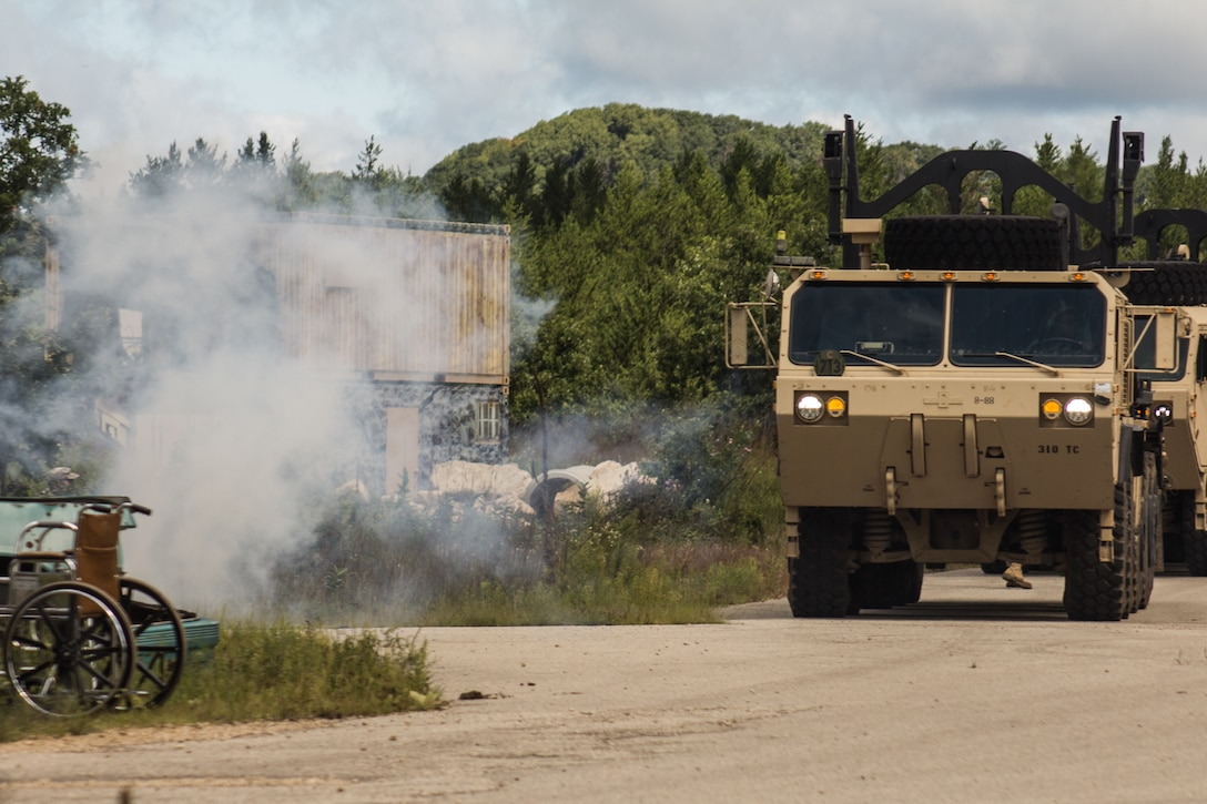 FORT MCCOY, Wis. – A heavy expanded mobility tactical truck delivering humanitarian aid supplies, driven by a U.S. Army Reserve Soldier with the 459th Transportation Company from Elwood, Ill., is immobilized by a mock improvised explosive device during a combat support training exercise at Fort McCoy, Wis., Aug. 21, 2016. (U.S. Army Reserve photo by Sgt. Clinton Massey, 206th Broadcast Operations Detachment)