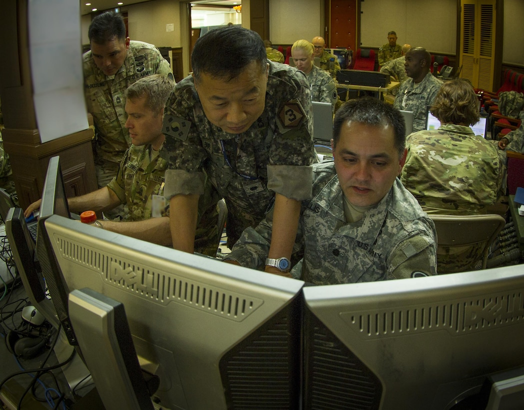 U.S. Army Lt. Col. Troy Ellis (right), the deputy of civil military operations for I Corps, and Korean Army Lt. Col. Seunghoon Lee, Third Republic of Korea Army liaison officer, work together at Yongin, South Korea during a two-week training exercise, Aug 24, 2016. (U.S. Army photo by Staff Sgt. Ken Scar)
