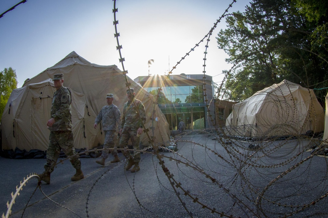 U.S. Army Soldiers exit an operations center at Yongin, South Korea, Aug. 25, 2016.  (U.S. Army photo by Staff Sgt. Ken Scar)