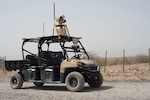 A mobile detection assessment response system patrols the perimeter of an airfield in Djibouti, July 9, 2016. It is an automated patrol vehicle able to navigate paths and detect threats in the vicinity. Air Force photo by Staff Sgt. Eric Summers Jr.
