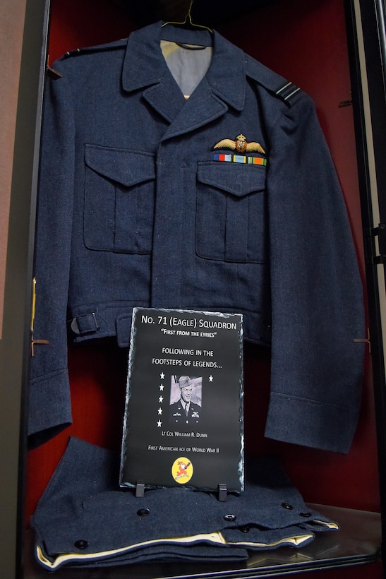 William Dunn's British Royal Air Force uniform is on display, along with a plaque, at the 334th Fighter Squadron, Aug. 24, 2016, at Seymour Johnson Air Force Base, North Carolina. Dunn was an American pilot with the No. 71 (Eagle) Squadron and became the first American ace of World War II. (U.S. Air Force photo by Airman Shawna L. Keyes)