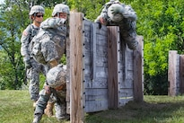 Soldiers climb over an obstacle during premobilization training at Fort Indiantown Gap, Pa., Aug. 16, 2016. Army National Guard photo by Sgt. Cesar Leon