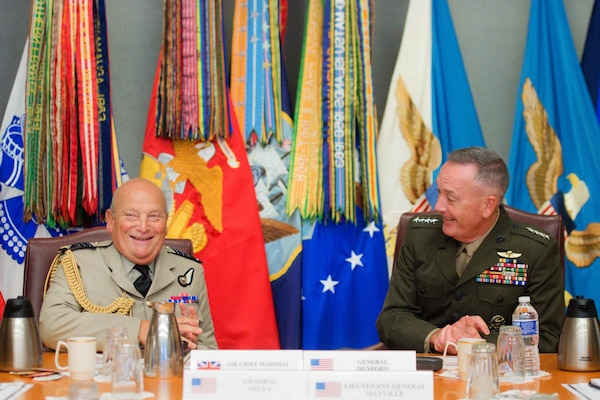 Marine Corps Gen. Joe Dunford, right, chairman of the Joint Chiefs of Staff, talks with Air Chief Marshal Sir Stuart Peach, chief of the Defense Staff of the United Kingdom, during a visit at the Pentagon Aug. 26, 2016. DoD photo by Navy Petty Officer 2nd Class Dominique A. Pineiro