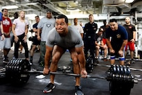 Navy Lt. Cmdr. Michael Blackman lifts 495 pounds during a deadlifting event aboard amphibious assault ship USS Boxer in the Pacific Ocean, Aug. 25, 2016. The Boxer, flag ship for Boxer Amphibious Ready Group, 13th Marine Expeditionary Unit team, is operating in the U.S. 3rd Fleet area of operations.  Navy photo by Petty Officer 1st Class Brian Caracci