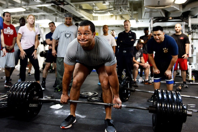 Navy Lt. Cmdr. Michael Blackman lifts 495 pounds during a deadlifting event aboard amphibious assault ship USS Boxer in the Pacific Ocean, Aug. 25, 2016. The Boxer is operating in the U.S. 3rd Fleet area of operations.  Navy photo by Petty Officer 1st Class Brian Caracci
