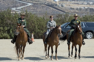 Gen. Lori Robinson, NORAD and USNORTHCOM Commander, is briefed on the Southwest Border Region via horseback with the U.S. Customs and Border Protection along the border near San Diego, Calif., Aug. 24, 2016.