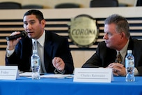 """NSWC Corona Division Command Contracts Manager Sean Foley, left, and Contracting Officer Charles Sam Rainwater participate in """"Doing Business with the Government"""" program at Corona City Hall.  Event organized as panel discussion to give small business owners insight into specific procurement procedures of City of Corona and other local government agencies."""