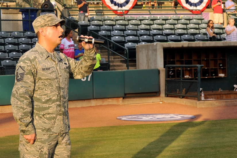 Master Sgt. Jason Gilbert, 628th Medical Operations Squadron superintendent, sings the national anthem during Military Appreciation Night, Aug. 24, 2016 at Joseph P. Riley Jr. Park in Charleston, S.C. The Charleston RiverDogs baseball team host military appreciation nights to show their support for the local military. (U.S. Air Force photo/Tech. Sgt. Renae Pittman)