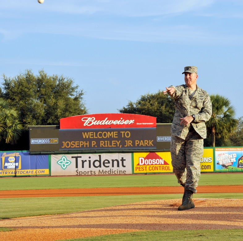 U.S. Air Force Col. Robert Lyman, Joint Base Charleston commander, throws the first pitch kicking off  Military Appreciation Night Aug. 24,2016, at Joseph P. Riley, Jr. ark in Charleston, South Carolina. The Charleston RiverDogs baseball team host military appreciation nights to show gratitude to local military members. (U.S. Air Force photo/Tech. Sgt. Renae Pittman)