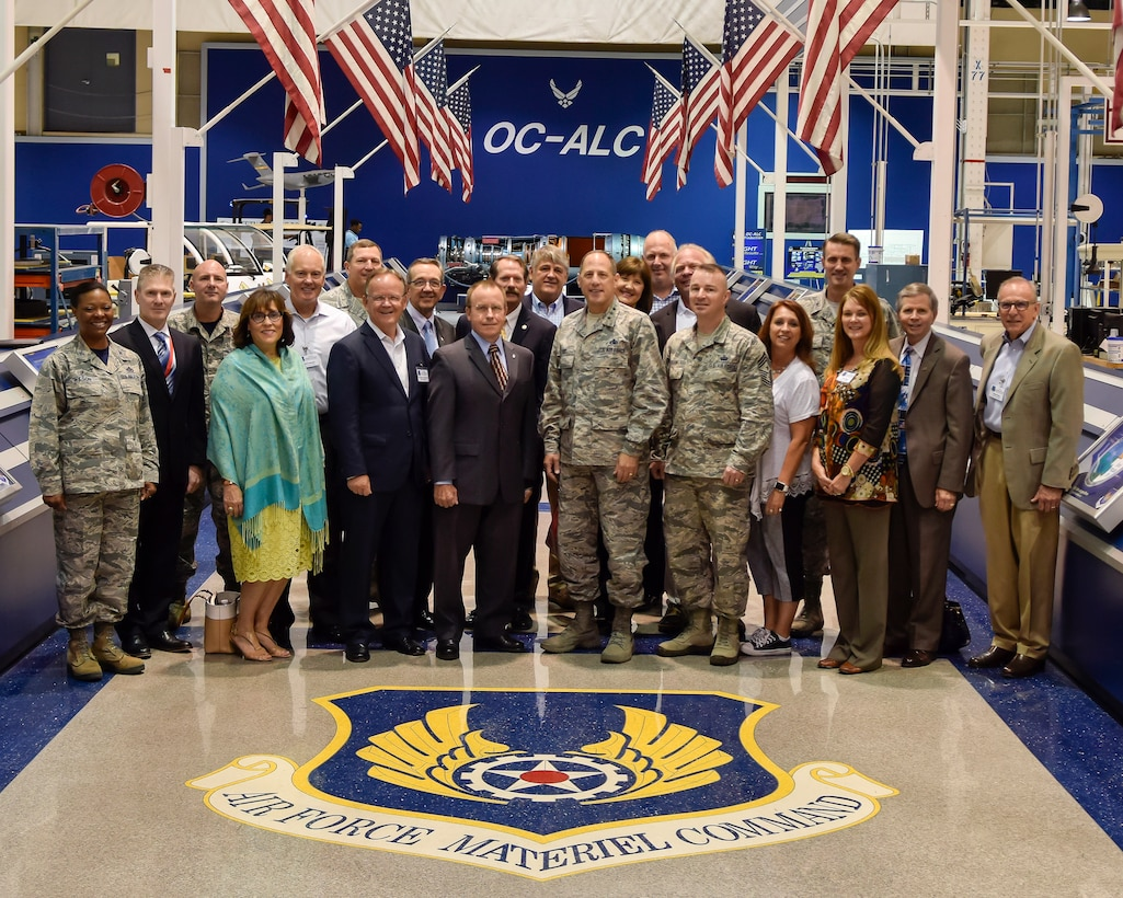 Group photo showing attendees of the Air Force Sustainment Center's Community Liaison Program Conference at Hollywood and Vine inside bldg. 3001, Aug. 26, 2016, Tinker Air Force Base, Okla. Lt. Gen. Lee K. Levy II, AFSC commander, hosted the conference to facilitate better understanding between military and community leaders. (U.S. Air Force photo/Greg L. Davis)