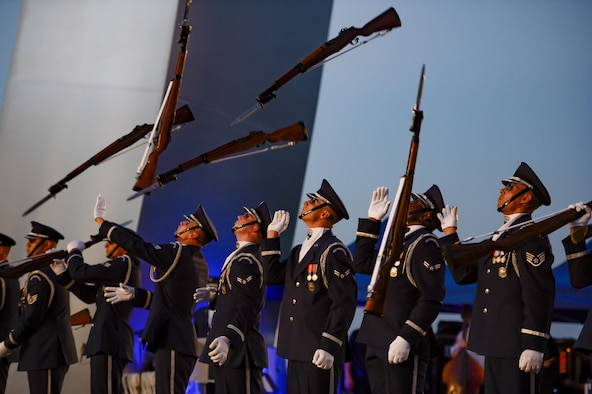 The U.S. Air Force Honor Guard Drill Team performs during a public U.S. Air Force Band concert at the Air Force Memorial to honor Vietnam War veterans Aug. 26, 2016, in Arlington, Va. Prior to attending the concert, Air Force Undersecretary Lisa S. Disbrow and Chief of Staff Gen. Dave Goldfein welcomed Gen. Stephen W. Wilson as the service's new vice chief of staff at a reception in the Fort Myer Officer's Club. (U.S. Air Force photo/Tech. Sgt. Joshua L. DeMotts)