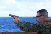 ABOARD USS BONHOMME RICHARD (LHD-6), At Sea (Aug. 26, 2016) – Col. Tye R. Wallace, commanding officer of the 31st Marine Expeditionary Unit, fires an M1911 .45-caliber pistol during live-fire training aboard the USS Bonhomme Richard (LHD-6), at sea, Aug. 26, 2016. The 31st MEU combines air-ground-logistics into a single unit with one commander, and is task-organized to address a wide variety of military operations in the Asia-Pacific region – from force projection and maritime security to humanitarian assistance and disaster relief in cooperation with host countries and partner militaries. (U.S. Marine Corps photo by Lance Cpl. Jay A. Parks/ Released)