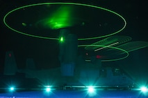 ABOARD USS BONHOMME RICHARD (LHD-6), At Sea, (Aug. 26, 2016) – An MV-22B Osprey with Marine Medium Tiltrotor Squadron 262 (Reinforced), idles atop the flight-deck of the USS Bonhomme Richard (LHD-6), as a separate MV-22B approaches to land during night qualifications at sea, Aug. 26, 2016.  The 31st MEU is the Marine Corps' only continuously forward-deployed Marine Air-Ground Task Force, and combines air-ground-logistics into a single team capable of addressing a range of military operations in the Asia-Pacific region – from force projection and maritime security to humanitarian assistance and disaster relief in cooperation with host countries and partner militaries. (U.S. Marine Corps Photo by Staff Sgt. T.T. Parish/Released)