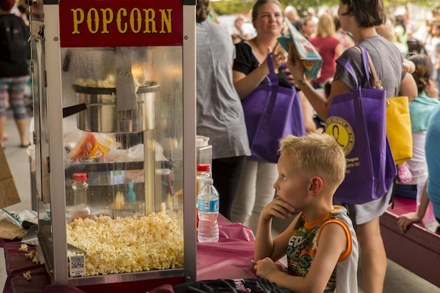 A student from Matthew C. Perry Elementary School waits for popcorn during the Back to School Bash at Marine Corps Air Station Iwakuni, Japan, Aug. 26, 2016. This school year will mark the last first day of school for students at the old M.C. Perry buildings. Elementary school students enjoyed concessions and games, posed for photos with McGruff, the Provost Marshal's Office's mascot, toured a fire truck and PMO police cruiser before receiving their new teacher assignments and touring the school. (U.S. Marine Corps photo by Lance Cpl. Aaron Henson)