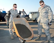 Air Force Chief Master Sgt. Steve Nichols, right, command chief with the 60th Air Mobility Wing; and Air Force Airman Joseph Sherwood, a pavements and equipment apprentice with the 60th Civil Engineer Squadron; pour concrete during the Works With Airmen program at Travis Air Force Base, Calif., Aug. 19, 2016. Sherwood is a pavements and equipment apprentice with the 60th Civil Engineer Squadron. Air Force photo by Louis Briscese