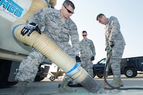 Air Force Col. John Klein, right, commander of the 60th Air Mobility Wing; and Air Force Chief Master Sgt. Steve Nichols, command chief of the 60th Air Mobility Wing; repair a section of concrete on the flightline during the Works With Airmen program at Travis Air Force Base, Calif., Aug. 19, 2016. Air Force photo by Louis Briscese