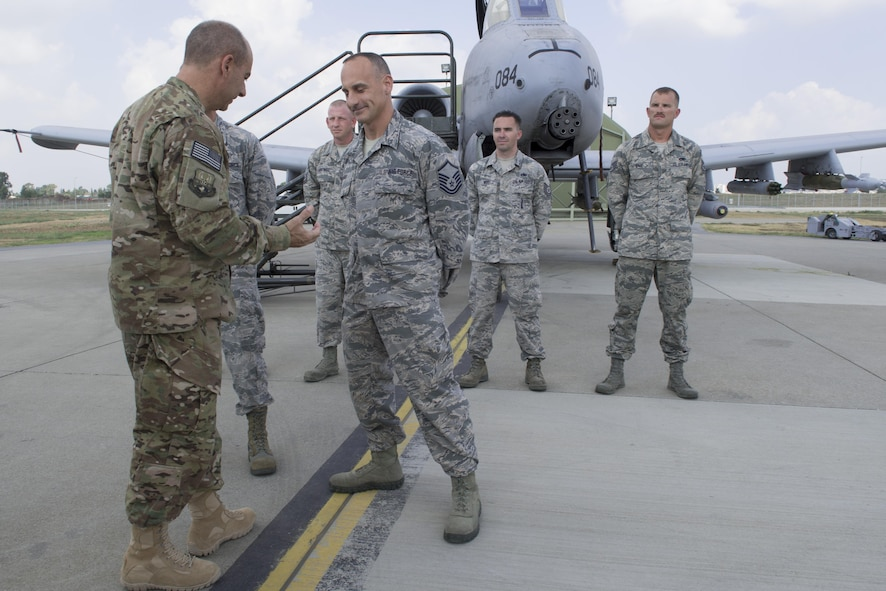 U.S. Air Force Lt. Gen. Jeffrey Harrigian, U.S. Air Forces Central Command commander, coins Master Sgt. Samuel Mulvany, 124th Aircraft Maintenance Squadron, from Gowen Field, Idaho, at Incirlik Air Base, Turkey, Aug. 28, 2016. The A-10 Thunderbolt II deployed to Incirlik AB in October 2015 in support of Operation Inherent Resolve to enhance the international Coalition against Da'esh. (U.S. Air Force photo by Staff Sgt. Ciara Gosier)