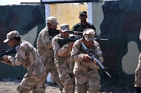 A team of Iraqi army ranger students conducts a glass house room clearing drill as their leadership watches at Camp Taji, Iraq, July 18, 2016. This drill, conducted within a diagram or outline of a building, allows the students to practice room clearing techniques while in full view of their trainers. Camp Taji is one of four Combined Joint Task Force – Operation Inherent Resolve build partner capacity locations dedicated to training Iraqi security forces. (U.S. Army photo by 1st Lt. Daniel Johnson/Released)