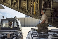 Air Force Staff Sgt. Dallion Richards operates a cargo loader at Bagram Airfield, Afghanistan, Aug. 19, 2016. Richards is a loadmaster assigned to the 774th Expeditionary Airlift Squadron. Aircraft loadmasters are responsible for properly loading, securing and escorting cargo and passengers, and ensuring the plane is properly balanced with the weight of the cargo evenly distributed. Air Force photo by Senior Airman Justyn M. Freeman