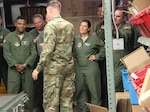 Students in the Advanced Study of Air Mobility Program from USAF Expeditionary Center, Joint Base McGuire-Dix-Lakehurst, N.J. receive a tour of DoD's largest warehouse from United States Army Lt. Col. Jacob Freeman.