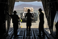 Air Force Senior Airman Andrew Garrett, center, uses hand signals to direct a vehicle off a C-130J Super Hercules aircraft at Bagram Airfield, Afghanistan, Aug. 19, 2016. Garrett is assigned to the 774th Expeditionary Airlift Squadron. Air Force photo by Senior Airman Justyn M. Freeman