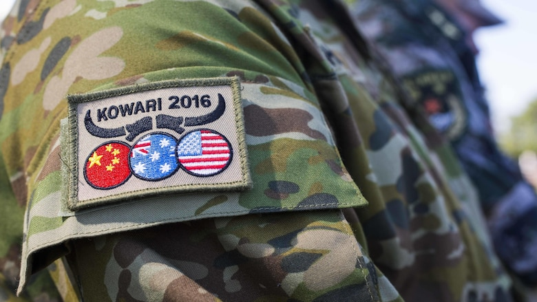 U.S. Marines and soldiers, Australian Army soldiers, and People's Liberation Army soldiers receive a patch during Exercise Kowari's opening ceremony at Larrakeyah Barracks, Northern Territory, Australia, August 26, 2016. The purpose of Exercise Kowari is to enhance the United States, Australia, and China's friendship and trust, through trilateral cooperation in the Asia-Pacific and Indian Ocean Rim regions.