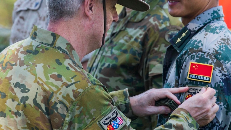 Brigadier Damian Cantwell, the Exercise Kowari commander, gives a patch to all the participants of Exercise Kowari at Larrakeyah Barracks, Northern Territory, Australia, August 26, 2016. The purpose of Exercise Kowari is to enhance the United States, Australia, and China's friendship and trust, through trilateral cooperation in the Asia-Pacific and Indian Ocean Rim regions.