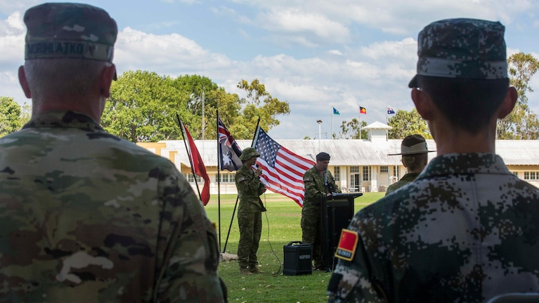 Australian officials welcome U.S. Marines and soldiers, Australian Army soldiers, and People's Liberation Army soldiers during Exercise Kowari's opening ceremony at Larrakeyah Barracks, Northern Territory, Australia, August 26, 2016. The purpose of Exercise Kowari is to enhance the United States, Australia, and China's friendship and trust, through trilateral cooperation in the Asia-Pacific and Indian Ocean Rim regions.
