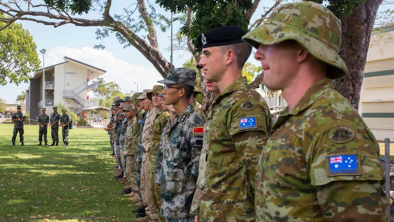U.S. Marines and soldiers, Australian Army soldiers, and the People's Liberation Army soldiers stand at attention during Exercise Kowari's opening ceremony at Larrakeyah Barracks, Northern Territory, Australia, August 26, 2016. The purpose of Exercise Kowari is to enhance the United States, Australia, and China's friendship and trust, through trilateral cooperation in the Asia-Pacific and Indian Ocean Rim regions.
